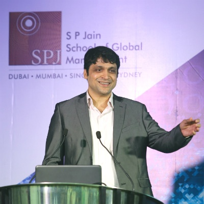 Mr. Purshottam Purswani, Chief Technologist, Head of Digital at ATOS India, delivers an engaging presentation on resolving digital dilemmas