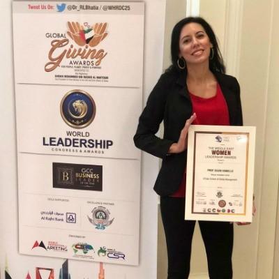Dr Silvia Vianello (Director of Innovation Centre, SP Jain Dubai) receives the Middle East Women Leadership Award