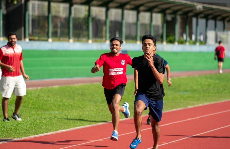 Nihel Jaison (right), SP Jain's MGB student, on his way to gold in the Men's 100m race
