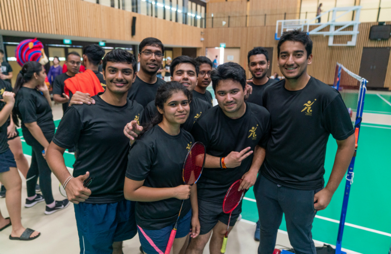 SP Jain's badminton team players pose for a picture with their supporters