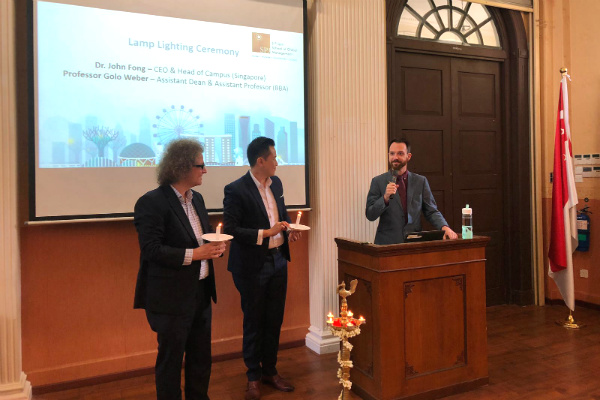 (Left to Right) Professor Golo Weber, Assistant Dean & Assistant Professor (BBA), Dr. John Fong, CEO & Head of Campus (Singapore) and Mr. Jim Faherty, Student Experience Manager, began the event with the lamp-lighting ceremony